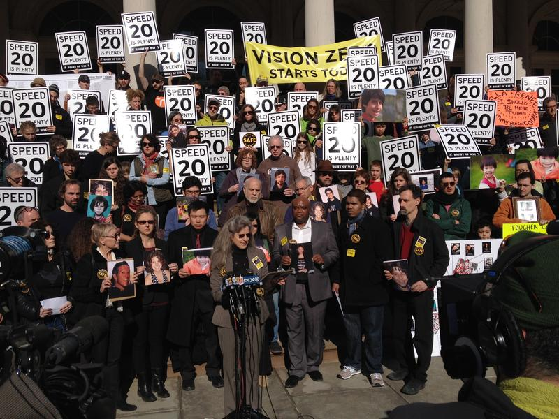 Amy Cohen (at podium) at a recent Families for Safe Streets Rally on the steps of City Hall