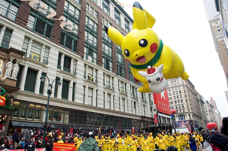 A balloon of Pikachu soars above the streets during Macy's Thanksgiving Day Parade
