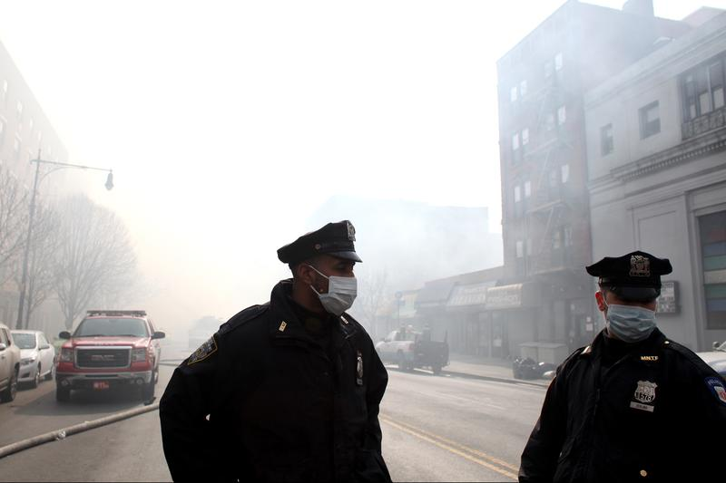 NYPD and hundreds of firefighters responded to a 5-alarm fire at the site of two building explosions in East Harlem on March 12, 2014.