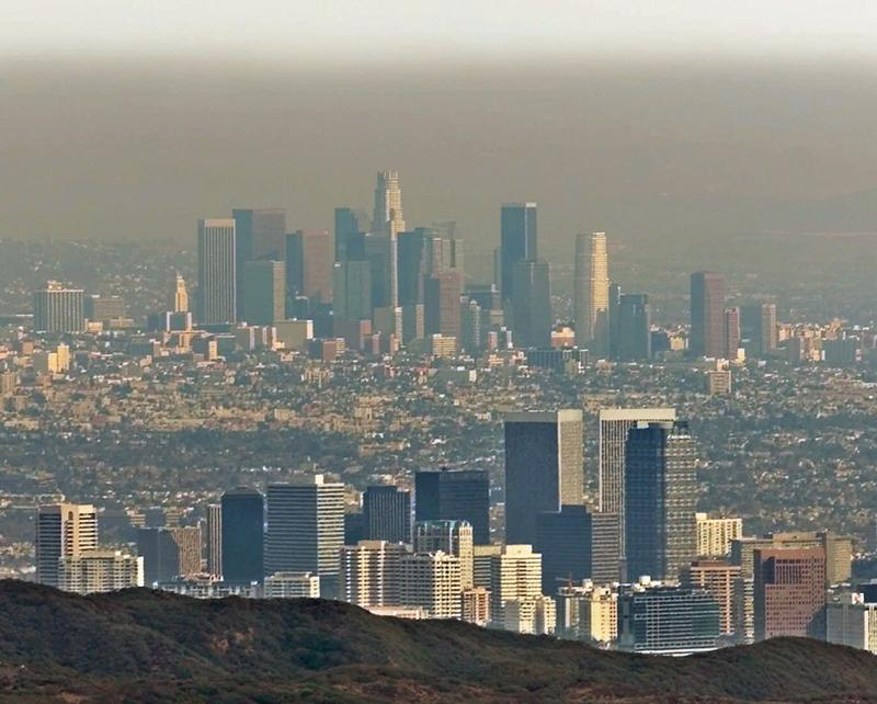 Century City, center, and downtown Los Angeles sit under a blanket of smog, Jan. 14, 2000.