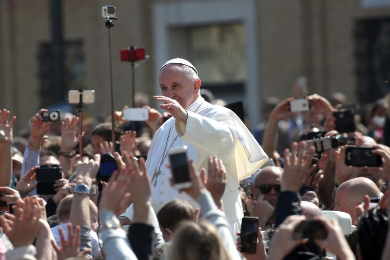 Pope Francis waves to the faithful gathered in St. Peter's Square at the end of the Easter Mass.