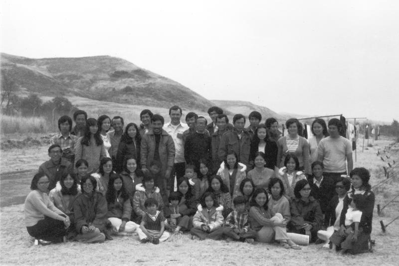 After the evacuation, the Saigon staff gathered outside the refugee tents at Camp Pendleton Marine Base, California, 1975.