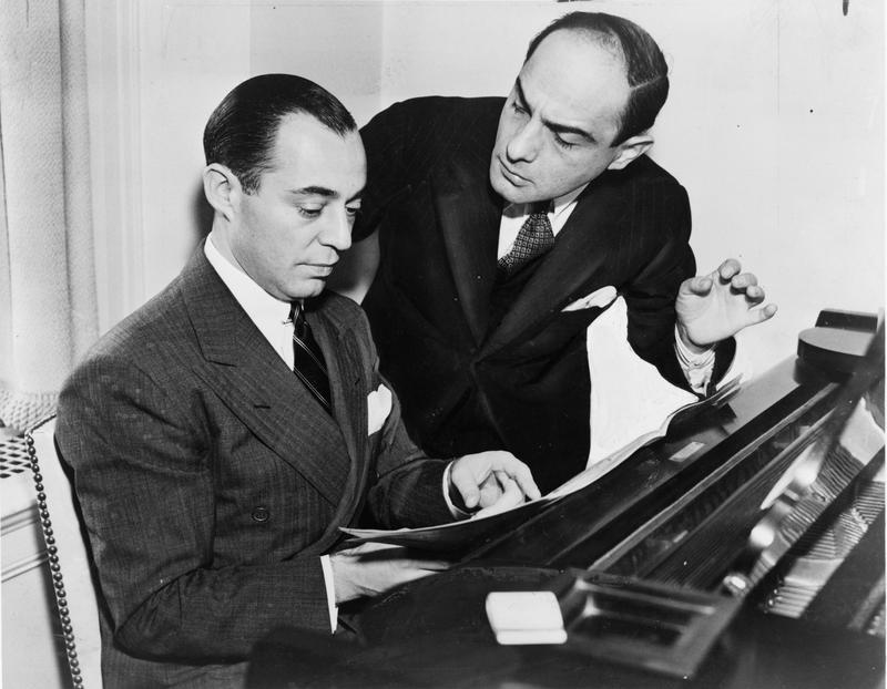 Richard Rodgers seated at piano with Lorenz Hart.