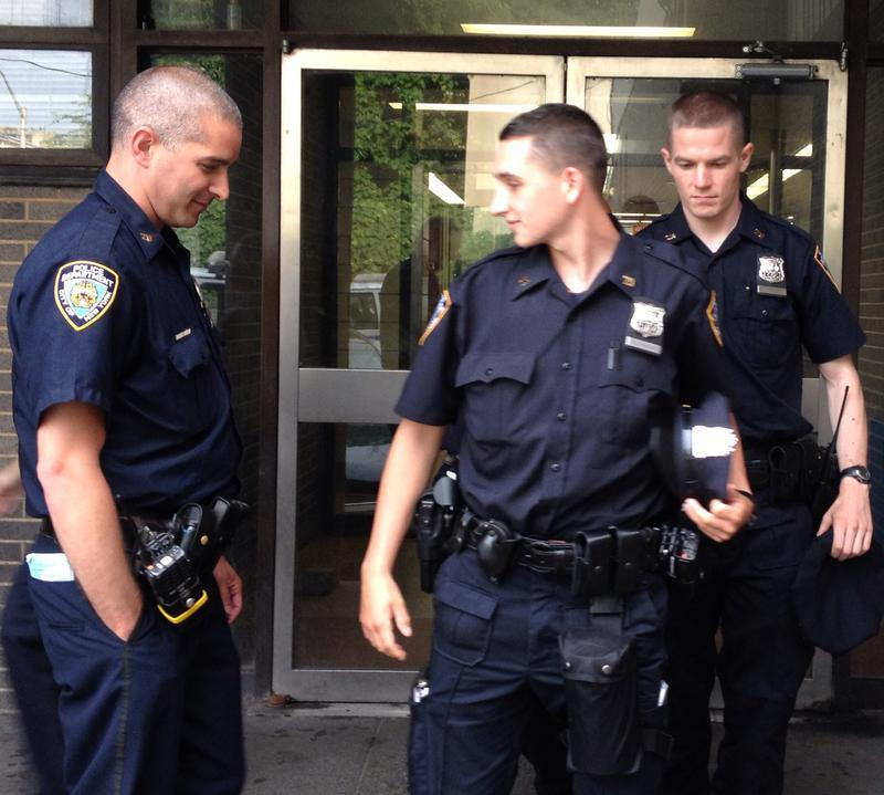 A veteran officer observes rookies leaving the 79th Precinct in the Partner Officer Program.
