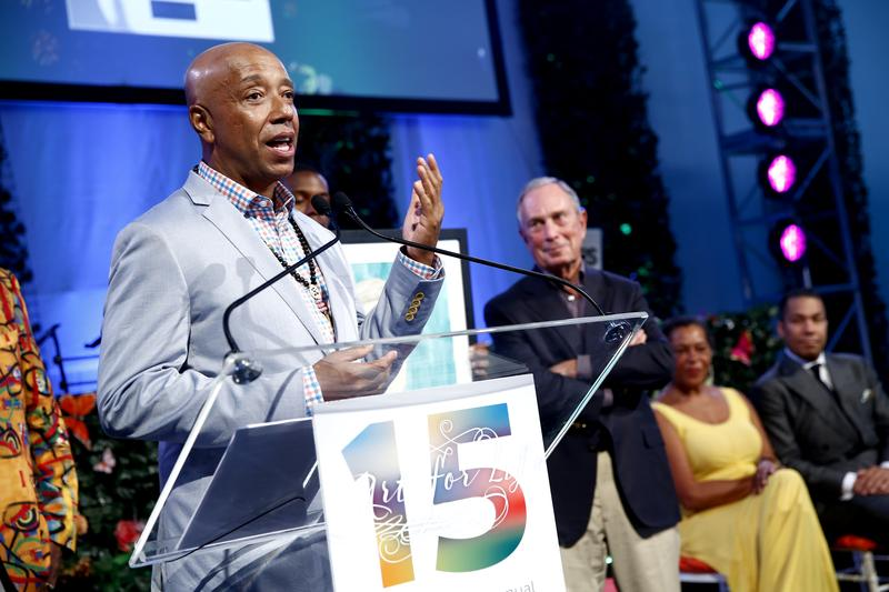 Co-founder of the Rush Philanthropic Arts foundation, Russell Simmons speaks on stage at the 15th annual Art for Life Gala hosted by Russell and Danny Simmons at Fairview Farms on July 26, 2014.