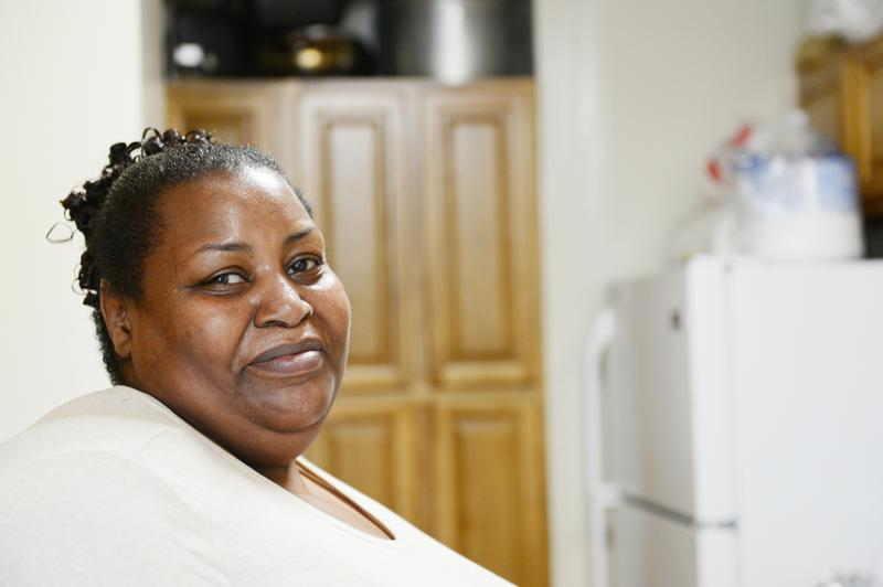 Dereese Huff stands in her renovated kitchen in the Campos Plaza housing project on the Lower East Side.