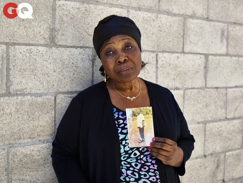 Heleine Tchayou, Charly's mother, holds a photograph of him as a student in Cameroon, before Paris, before America, before Skid Row.