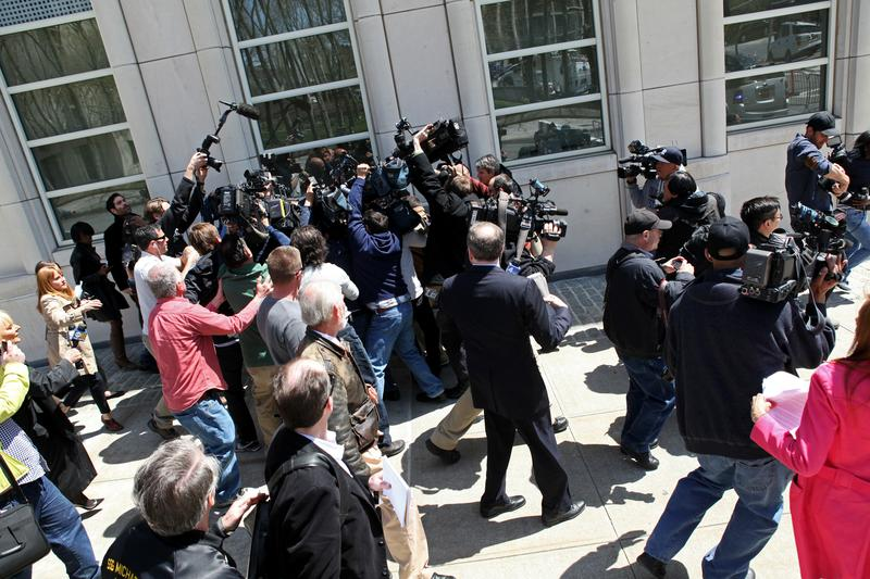 Staten Island congressman Michael Grimm is mobbed by reporters following his arraignment on federal fraud charges in Brooklyn. Grimm denies the allegations in the 20-count federal indictment.