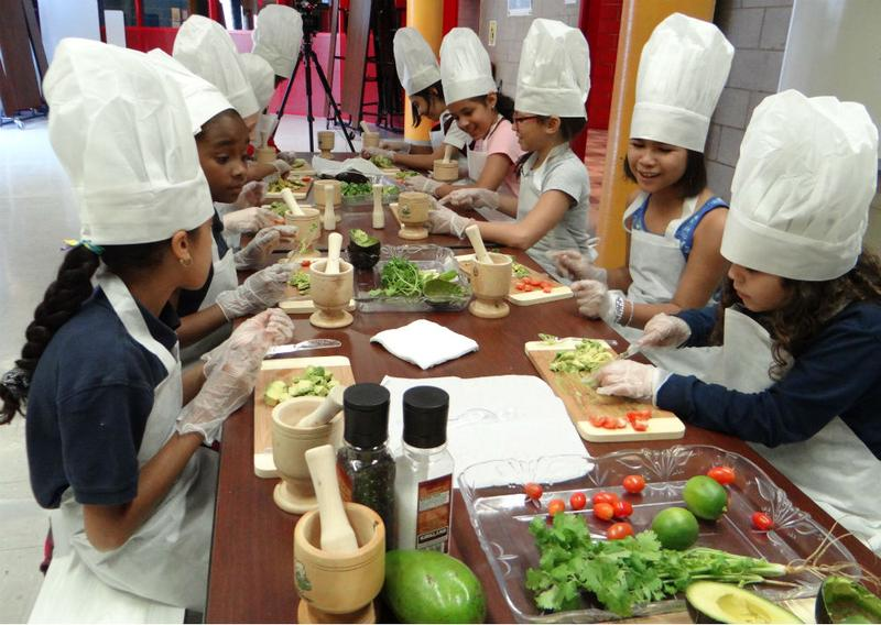 Kids making guacamole in a Coqui the Chef program in the South Bronx