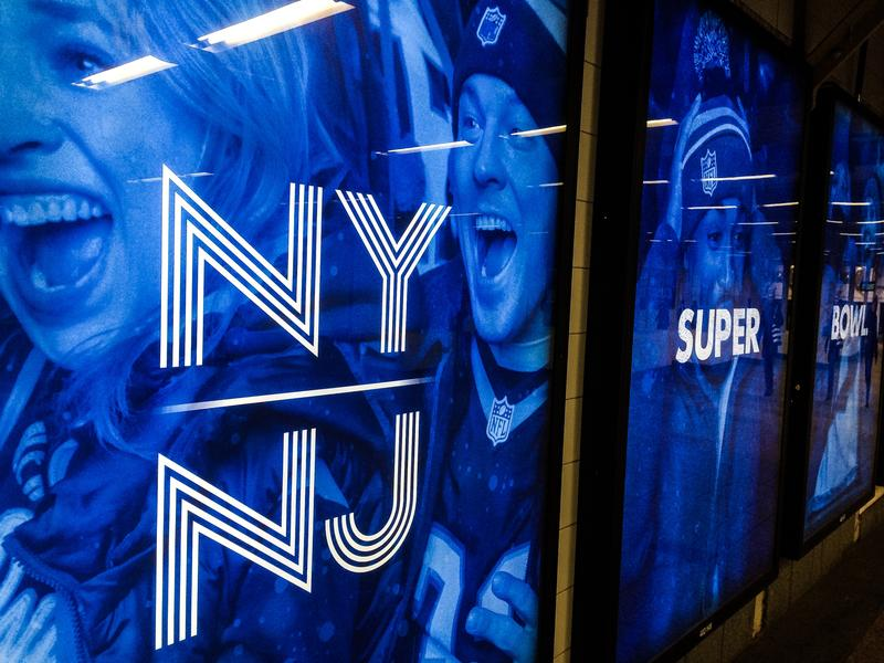 Super Bowl ads line Times Square as the area prepares to host its first Super Bowl.