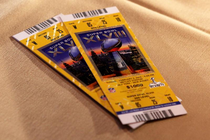 Super Bowl tickets on display, as authorities explain the security measures embedded in the tickets.