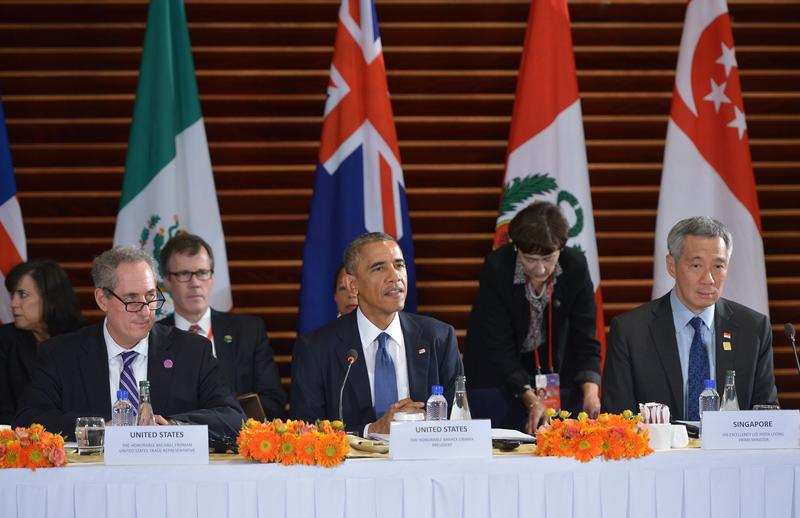 President Barack Obama speaks (C) during a meeting with leaders from the Trans-Pacific Partnership at the US Embassy in Beijing on November 10, 2014 in Beijing.