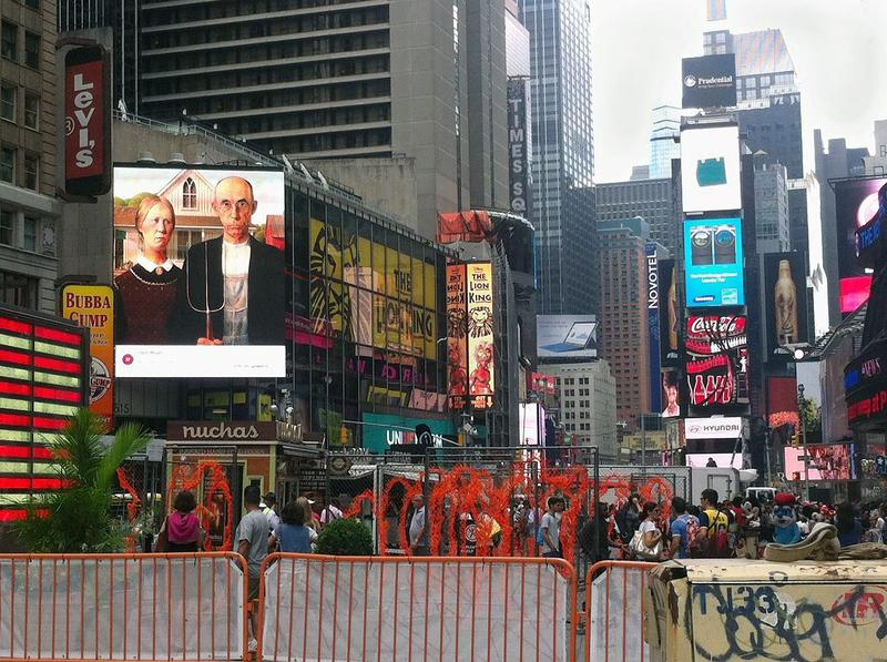 American Gothic, 1930, by Grant Wood, in a Times Square Billboard