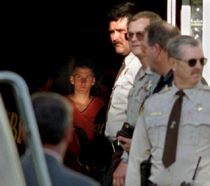 Timothy McVeigh about to be led out of a Perry, Oklahoma courthouse two days after the Oklahoma City bombing.