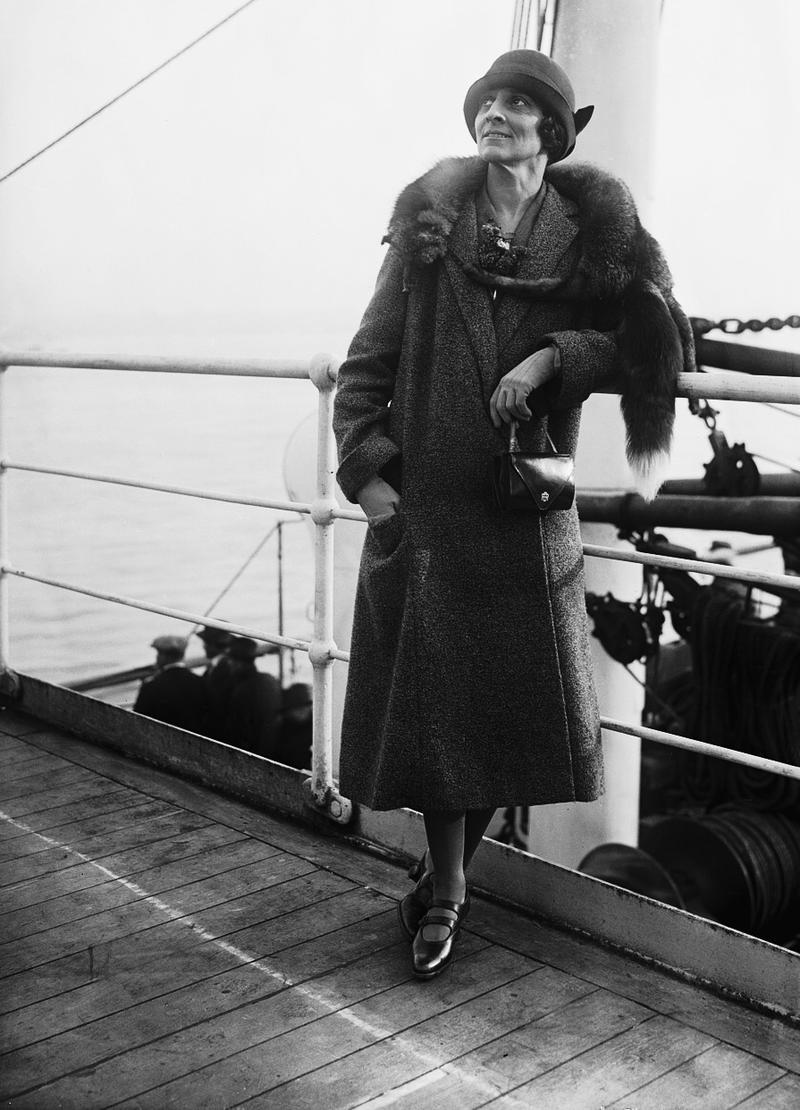 The actress Ruth Draper, posing on ship deck.