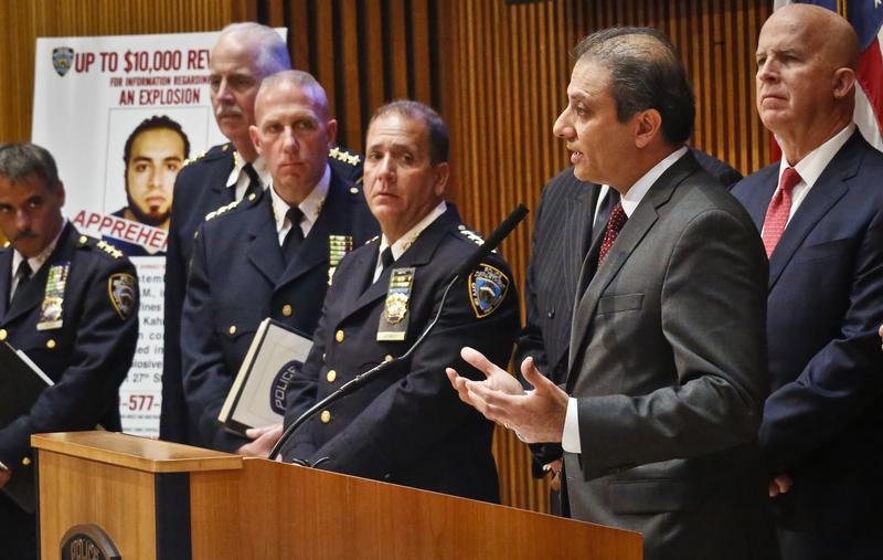US Attorney Preet Bharara, second from right, provides update on arrest of bombing suspect Ahmad Khan Rahami, Sept. 19, 2016, Police Headquarters, New York.