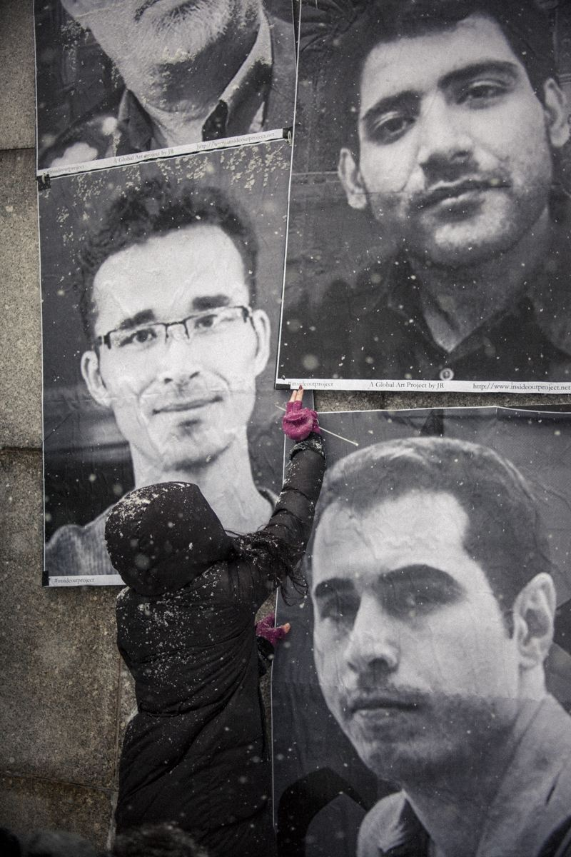 """On Feb 18 and 20, 2014, Unlock Iran and Inside Out Group Action, posted the photos of 13 Iranian """"prisoners of rights"""" across from the United Nations Headquarters and in Tompkins Square Park"""