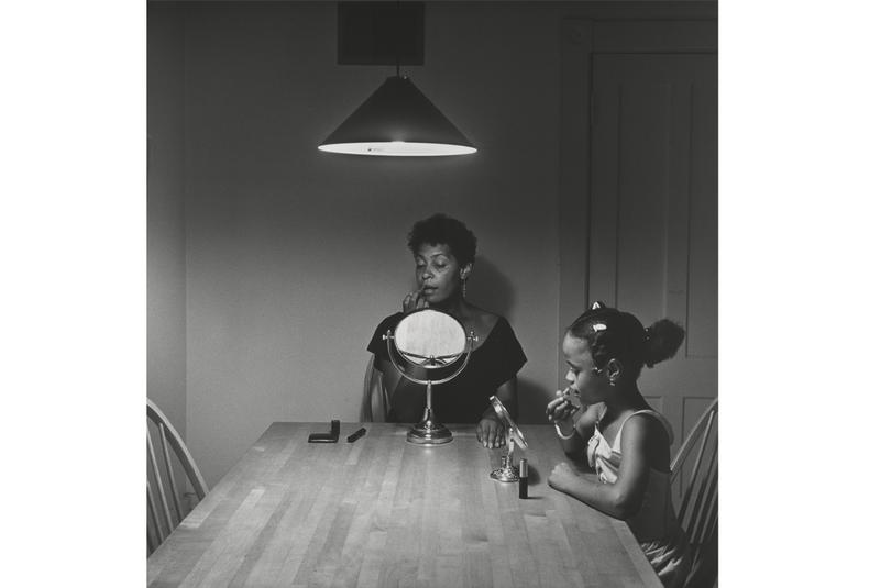 """Untitled (Woman and daughter with makeup)"" from Carrie Mae Weems' Kitchen Table Series. On display at the Guggenheim Museum through May 14."