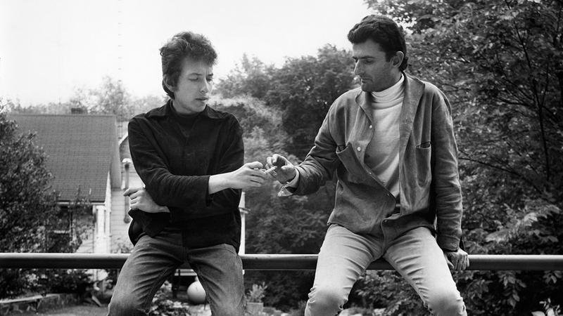 Bob Dylan and Victor Maymudes share a smoke in 1964.