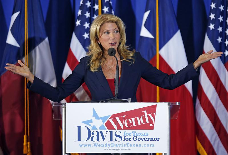 Texas State Sen. Wendy Davis (D) speaks at the podium as she announces her intentions to run for Texas Governor at the W.G. Thomas Coliseum in Haltom City on October 3, 2013 in Haltom City, Texas.