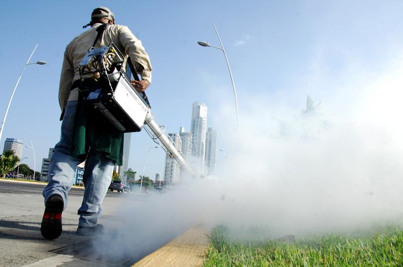 Health ministry workers fumigate against the Aedes aegypti mosquito, vector of the dengue, Zika and Chikungunya viruses in downtown Panama City on February 2, 2016.