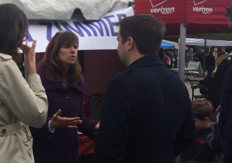 Hoboken Mayor Dawn Zimmer talks with constituents at a street festival in May.