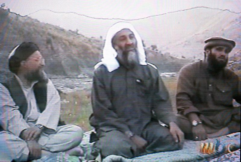 This frame grab from the Saudi-owned television network MBC (Middle East Broadcasting Center) shows alleged Al Qaida spokesman Suleiman Abu Ghaith sitting to the right of Osama bin Laden.