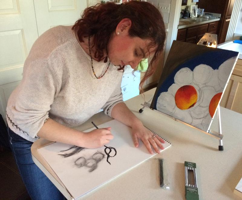 Adrienne Ognibene sketching next to her unfinished painting <em>Basket of Peaches</em>