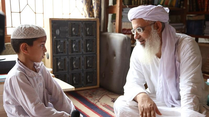 Cleric Abdul Aziz Ghazi with one of his students.