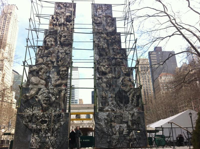 Producer Jodi Kaplan and artist Ben Tritt in front of his piece Analogia, at Bryant Park