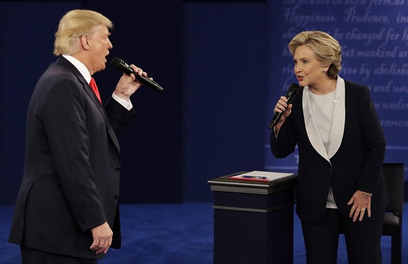 In this Sunday, Oct. 9, 2016, file photo, Republican presidential nominee Donald Trump and Democratic presidential nominee Hillary Clinton speak during the second presidential debate in St. Louis.