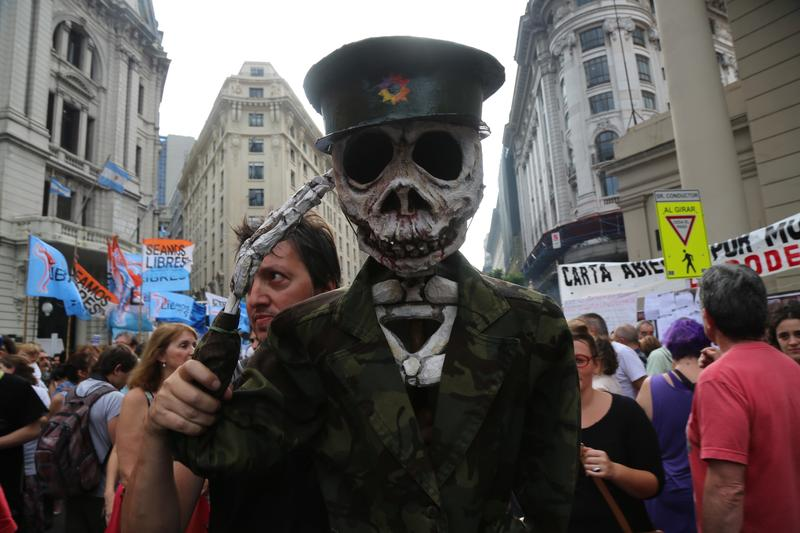 In Buenos Aires, a costumed demonstrator marks the anniversary of Argentina's 1976 military coup.
