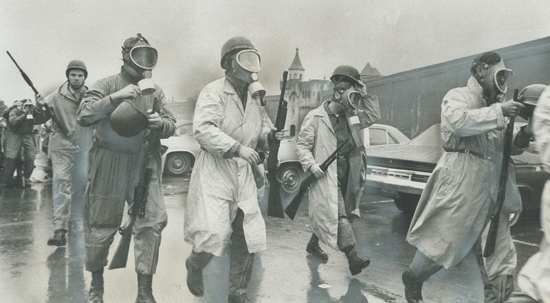 Saving in to crush riot; National Guardsmen wearing gas masks prepare to storm Cellblock D; the stronghold of the rebellious convicts at Attica; N.Y.; state prison.