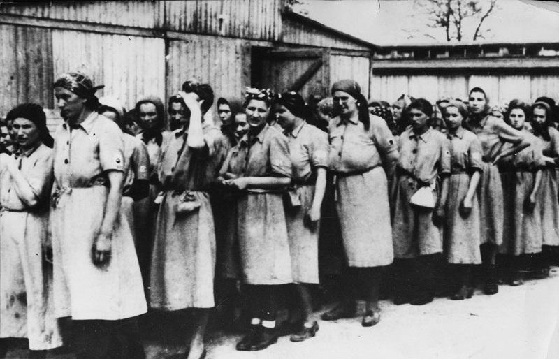 Women Auschwitz prisoners stand in a line after the Nazi concentration camp Auschwitz Poland was liberated by the Russians, January 1945.