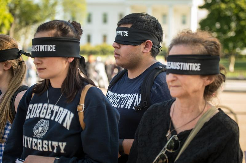 University students and staff from Reporters without Borders wear blindfolds during a rally in support of Austin Tice in front of the White House in Washington, D.C., on Monday, April 18, 2016.