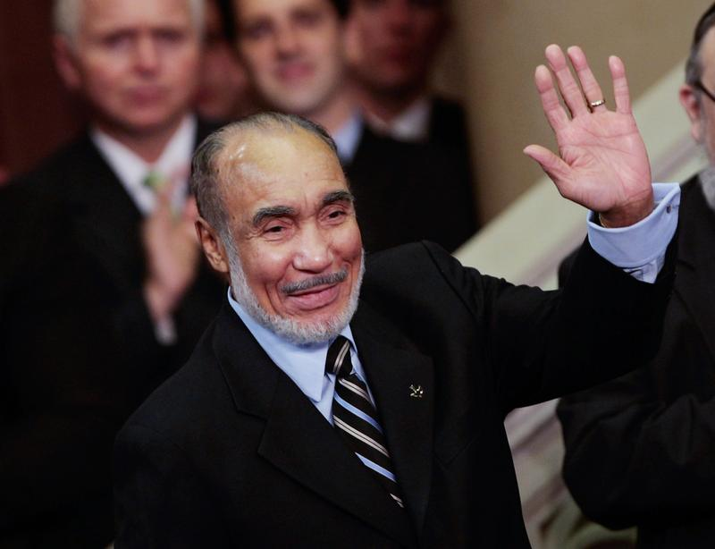 New York retired politician Basil Paterson, father of New York Gov. David Paterson, waves at his son's swearing-in ceremony March 17, 2008 in Albany.