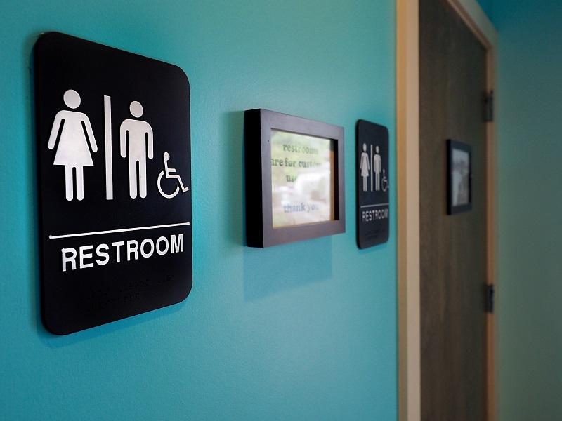 Unisex signs hang outside bathrooms at Toast Paninoteca on May 10, 2016 in Durham, North Carolina. Debate over transgender bathroom access spreads nationwide.