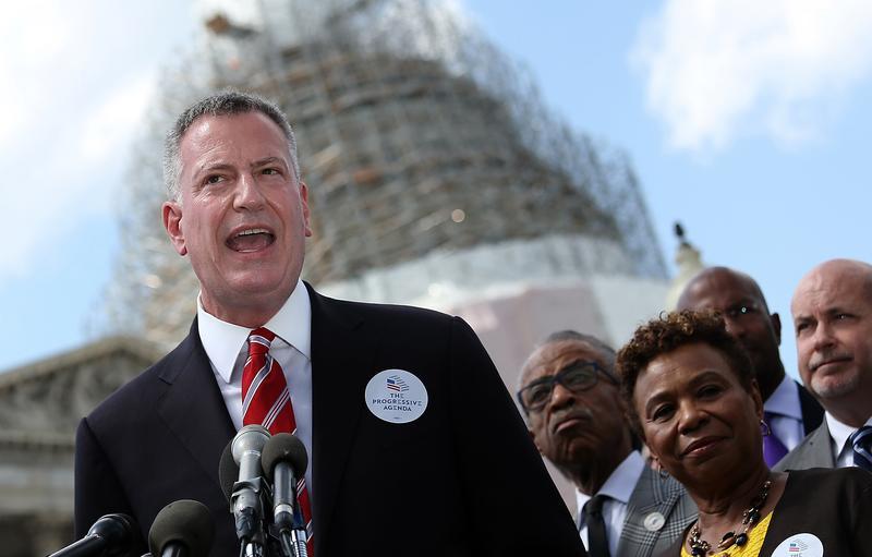 Mayor Bill de Blasio (L) speaks outside the U.S. Capitol May 12, 2015 in Washington, DC. De Blasio called for a 'progressive agenda to combat income inequality.'
