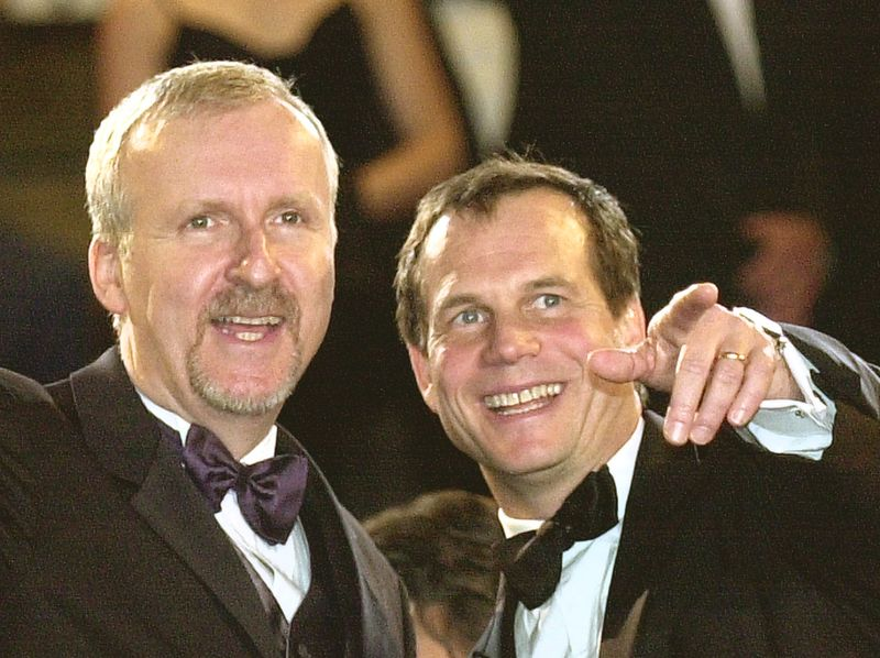 """James Cameron and Bill Paxton arrive for the screening of the documentary""""Ghosts Of The Abyss,"""" during the 56th Film Festival in Cannes, France, on May 17, 2003"""