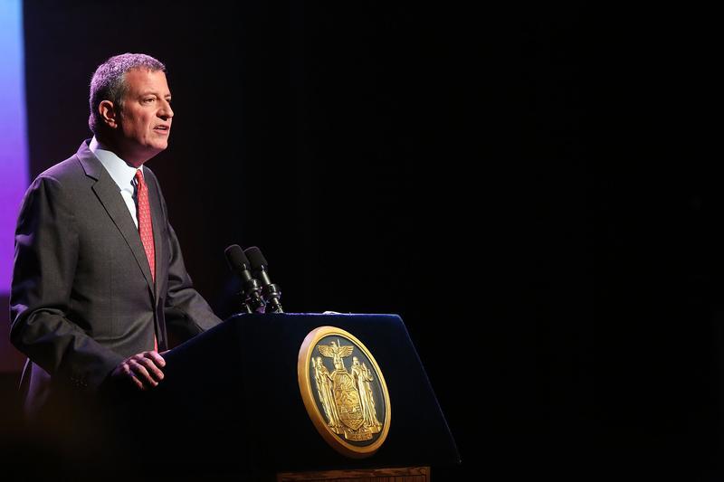 New York Mayor Bill de Blasio addresses a World AIDS Day gathering in Harlem on December 1, 2015 in New York City.