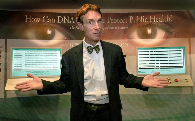 Bill Nye ('the Science guy') in front of a display showing how DNA research uncovered the SARS virus at the Marian Koshland Science Museum of the National Academy of Sciences.