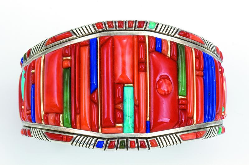 Bracelet Raymond C. Yazzie, 2005. Silver inlaid with coral, turquoise, lapis lazuli, 14-karat gold accents. 2 3/8 x 1 in.
