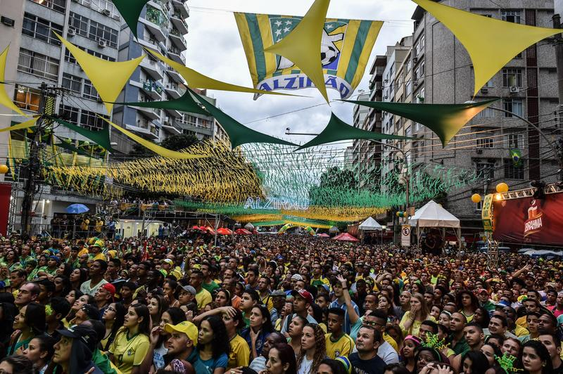Brazil's fans react during a public viewing event at a street in Rio de Janeiro during the 2014 FIFA World Cup semifinal match