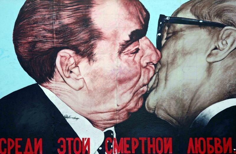 Mural on the Berlin Wall showing Brezhnev kissing Honecker.