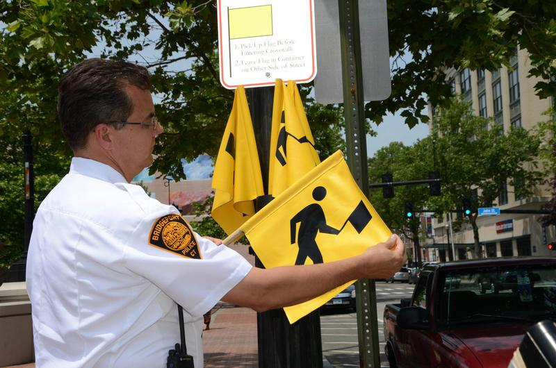 Bridgeport's police chief displaying one of six pedestrian crosswalk flags