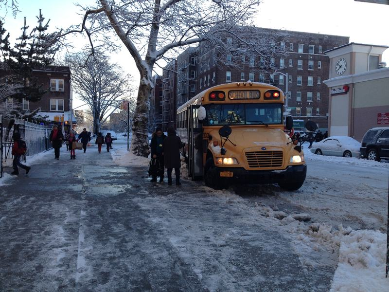 A school bus arrives at PS 230 in Brooklyn on Friday, February 14.