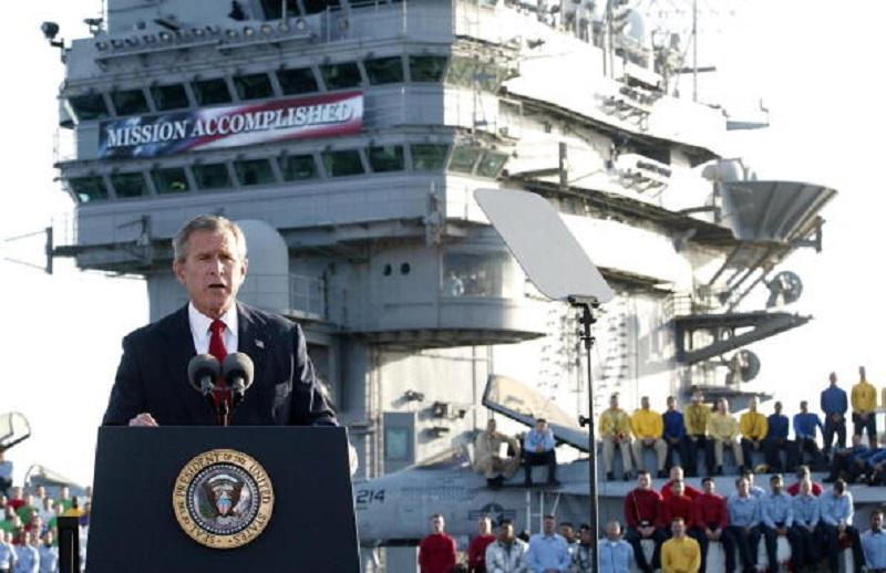US President George W. Bush addresses the nation aboard the nuclear aircraft carrier USS Abraham Lincoln 01 May, 2003, as it sails for Naval Air Station North Island, San Diego, California.