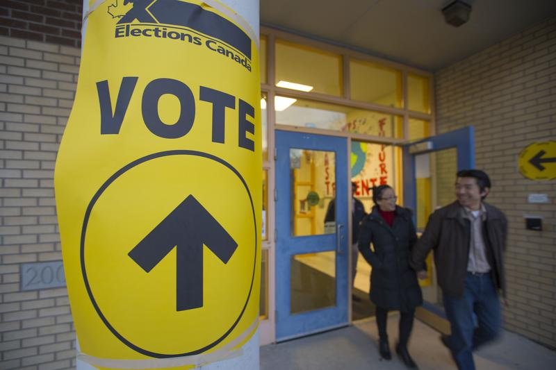 Voters leaving after casting their ballots at the Woodbridge Public School polling station in Canada in 2015.