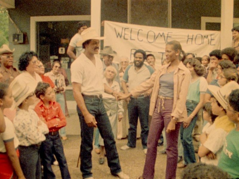"""Richard Romain and  Barbara Tasker surrounded by members of the community in Horace Jenkins's 1982 film """"Cane River"""""""