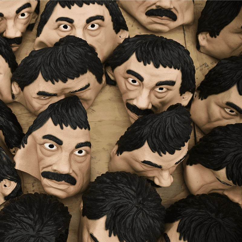 Masks of Mexican drug trafficker Joaquin Guzman Loera, aka 'El Chapo', are pictured in a factory of costumes and masks